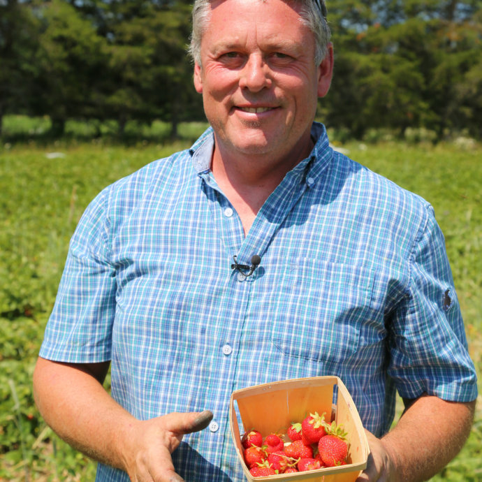 Michael, owener of Jemseg Farms with organic strawberries